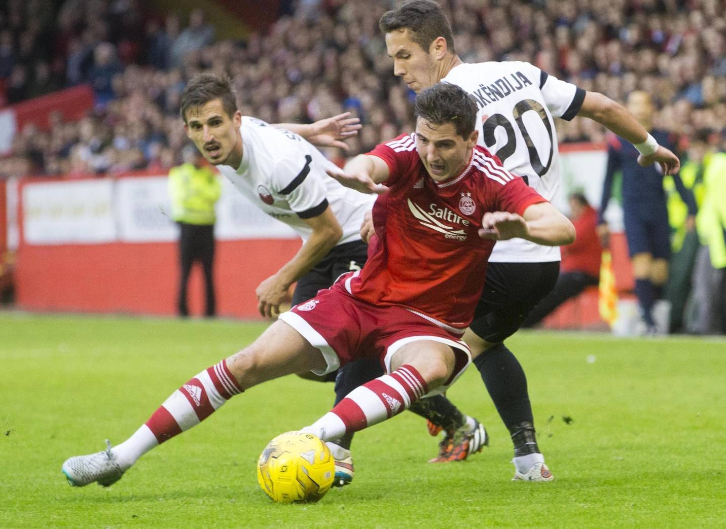 Aberdeen's Kenny Mclean  battles for the ball with Shkendija's Armend Alimi (left) and Victor Juffo (right) during the Europa League First Qualifying Round, Second Leg, at Pittodrie.