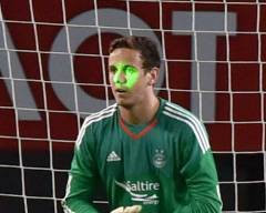 Opposing fans shone a laser pen into the eyes of Dons keeper Danny Ward
