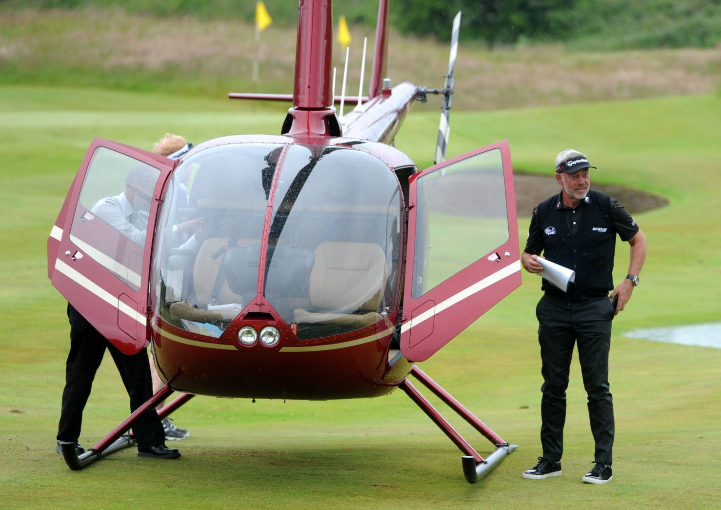 Darren Clarke arrived at  the Paul Lawrie Golf Centre by helicopter today