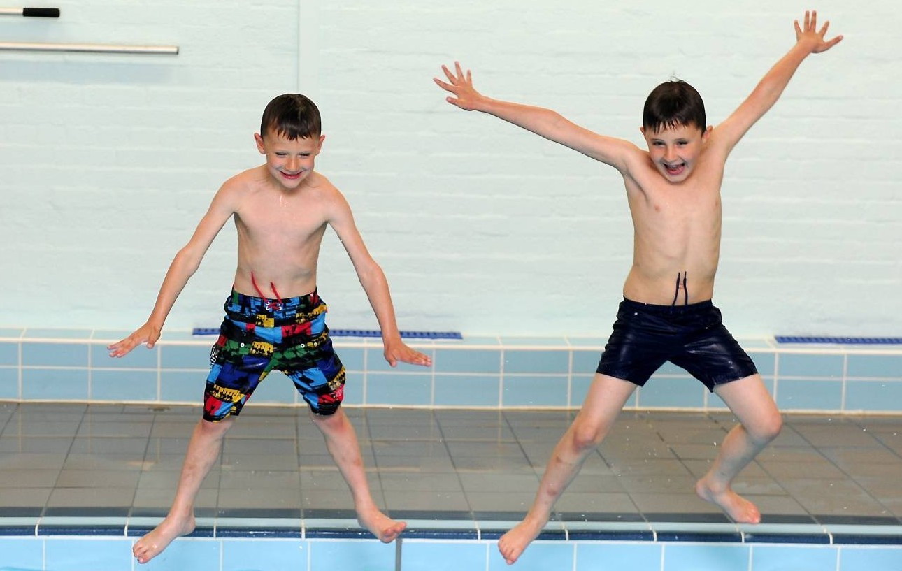 Oliver McNeill, 7 and Jack McNeill, 8 at the Tullo's Swimming Pool.
