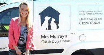 Miss Scotland finalist Tessa Forbes pictured with her donations at Mrs Murray's Cat and Dog home with Peaches the Staffie.