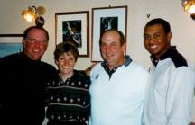 The couple with Open champions Mark O'Meara and a young Tiger Woods.