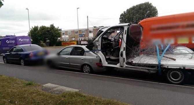 Car tows truck