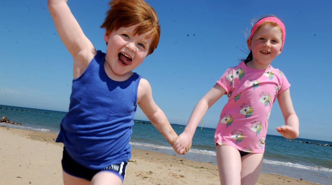 Brother and sister, Andrew, 5 and Amy Watson,8 play on the beach.