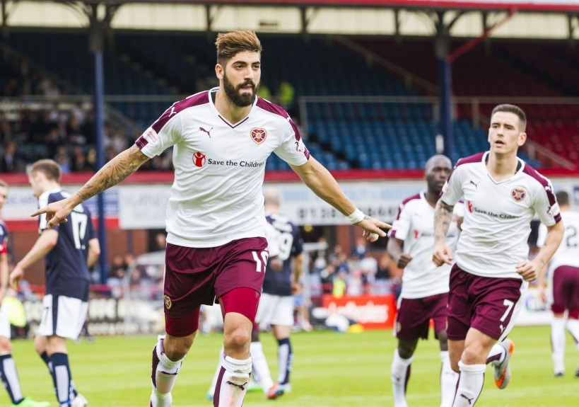 Juanma Delgado (left) wheels away in celebration after netting the equaliser for Hearts