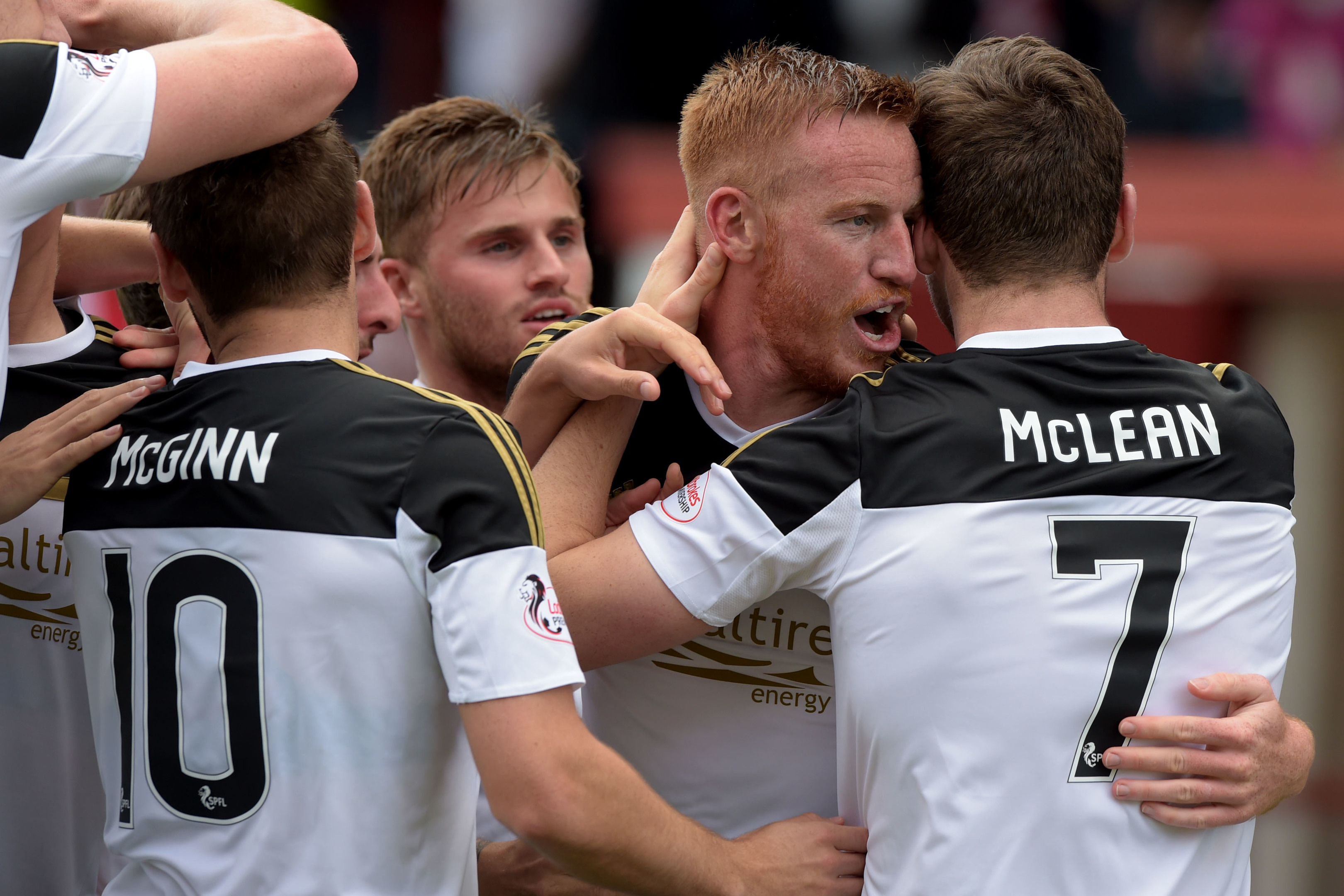 Adam Rooney celebrates his goal with Aberdeen team-mate Kenny McLean