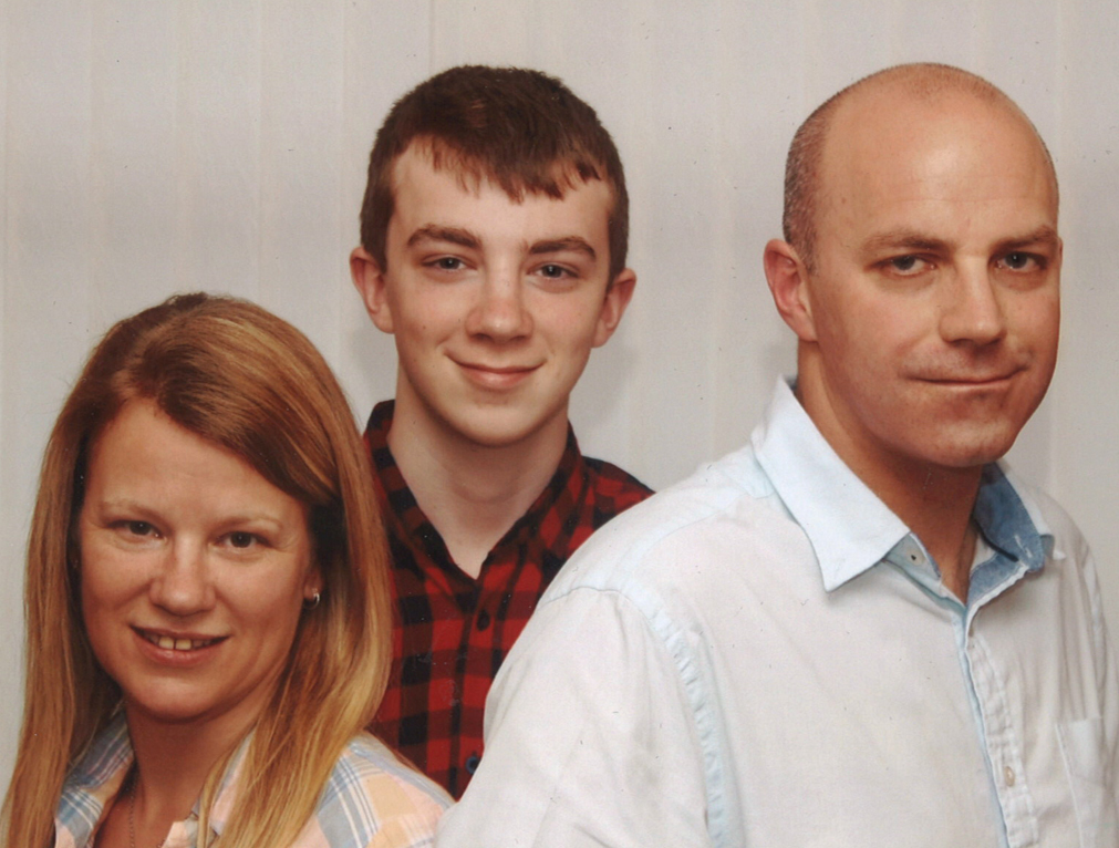 Mum and dad Angela and Mark McLean with son Michael who died after being injured on a summer job