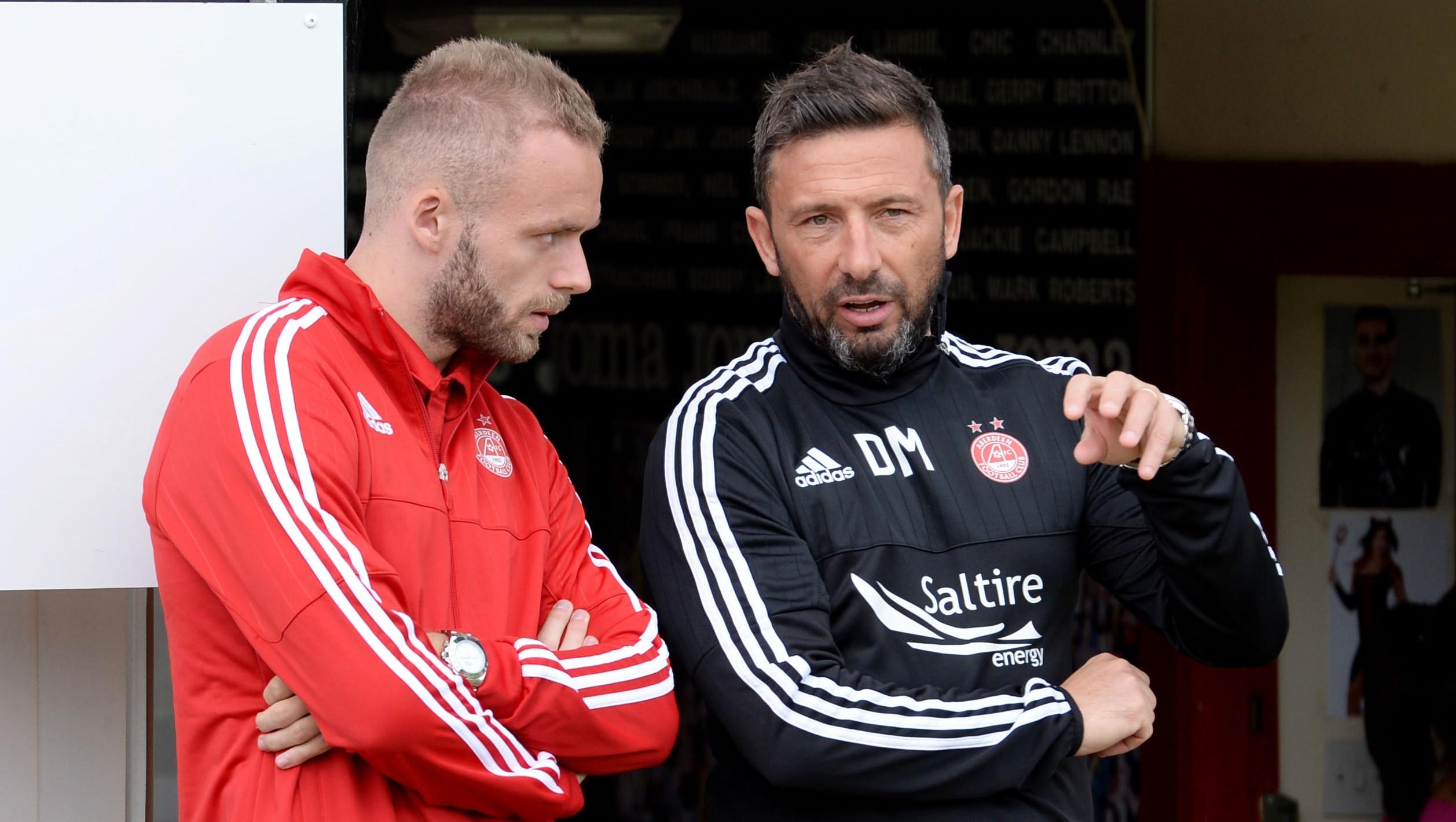 Aberdeen's Ryan McLaughlin, left,  listens to his manager Derek McInnes at Firhill.