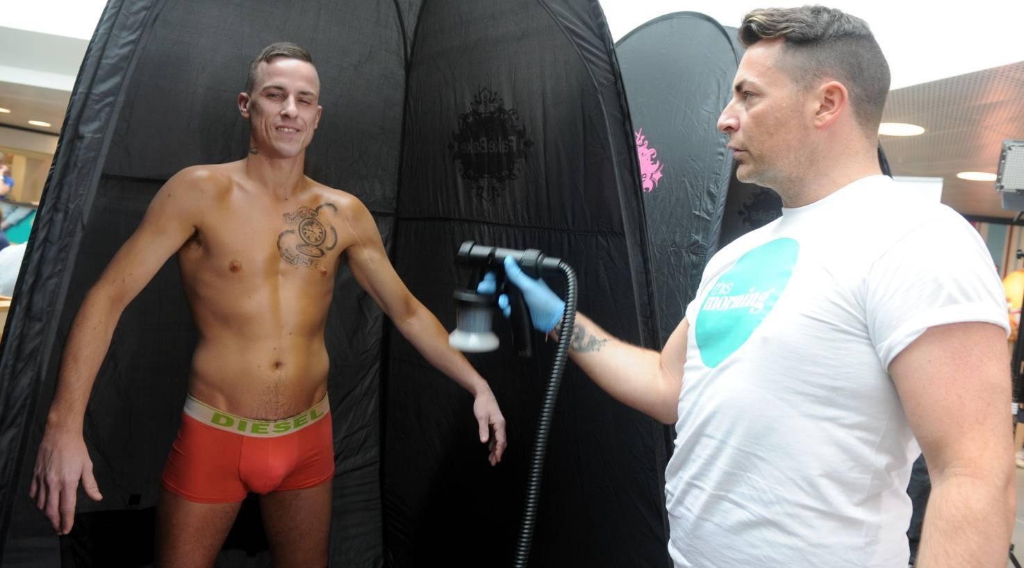 William Kinnaird gets sprayed by Craig-Alexander Wilson at the Bon Accord Centre.