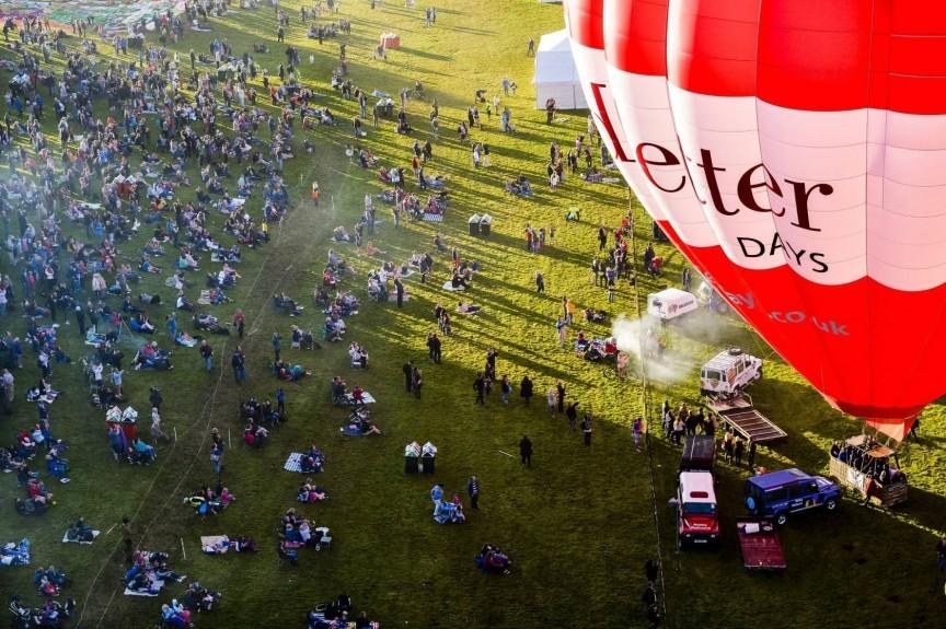 Hot air balloons lift off during the first mass ascent at the 37th Bristol International Balloon Fiesta at Ashton Court Estate, Bristol. Ben Birchall/PA Wire