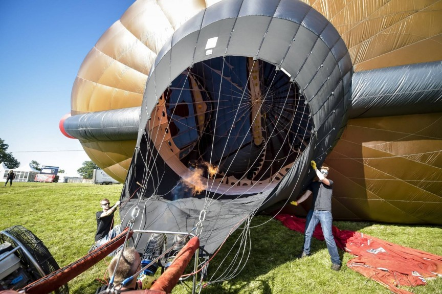 The worlds largest hot air balloon shape is inflated and tethered at the 37th Bristol International Balloon Fiesta at Ashton Court Estate, Bristol.