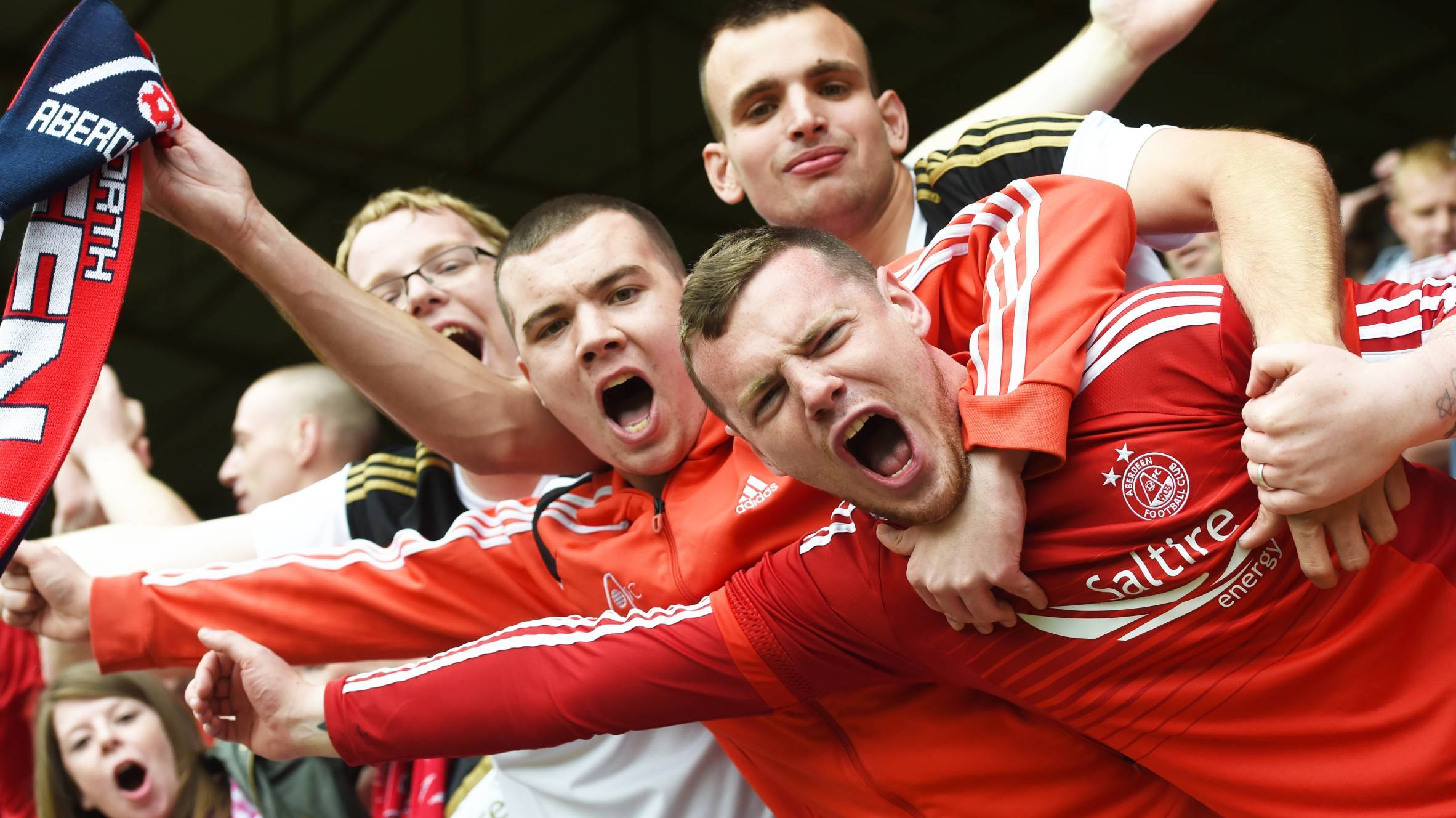 Dons fans celebrate their victory again Dundee United