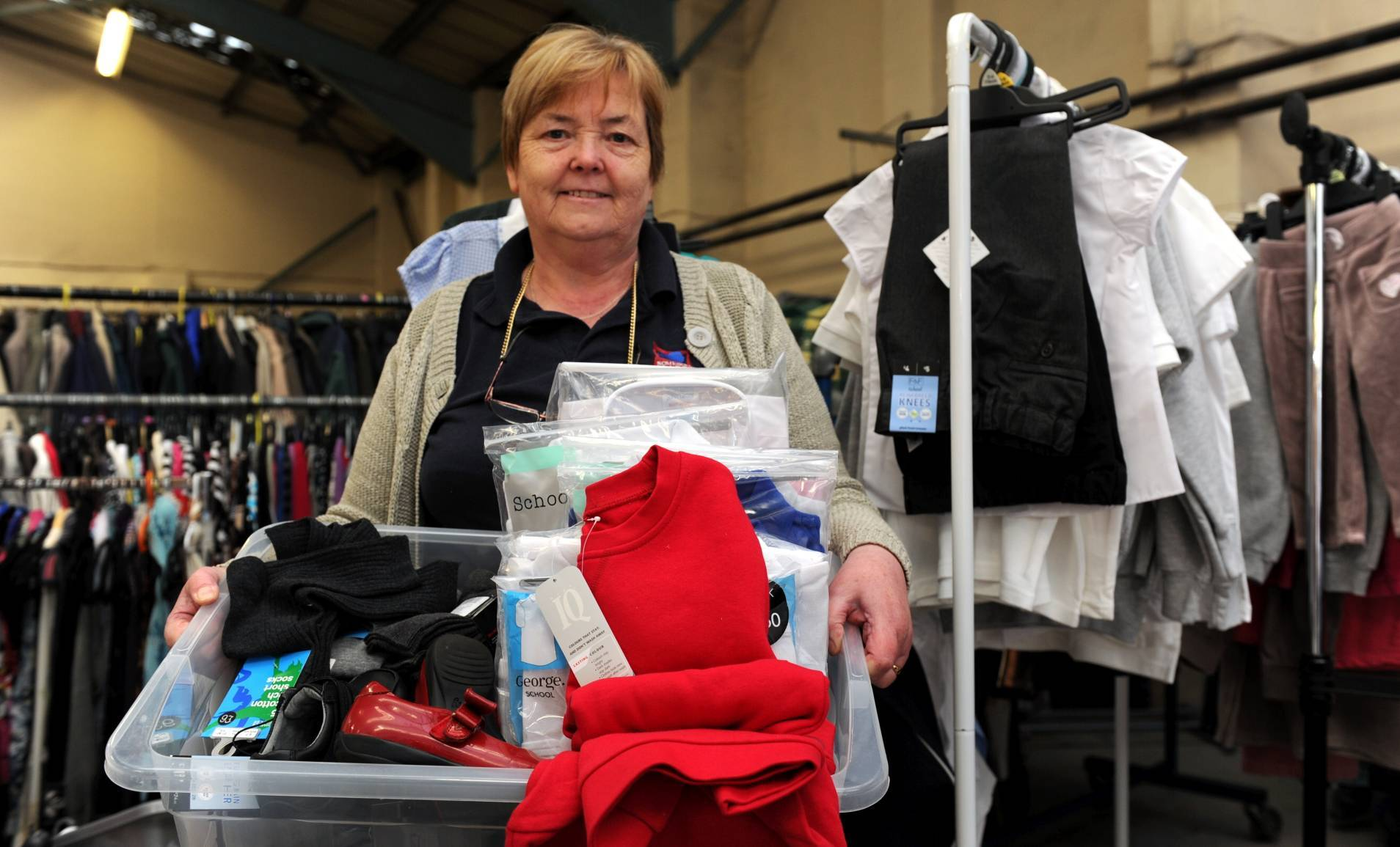 Jenny Taylor is pictured  with some of the school uniforms donated to charity Somebody Cares.
