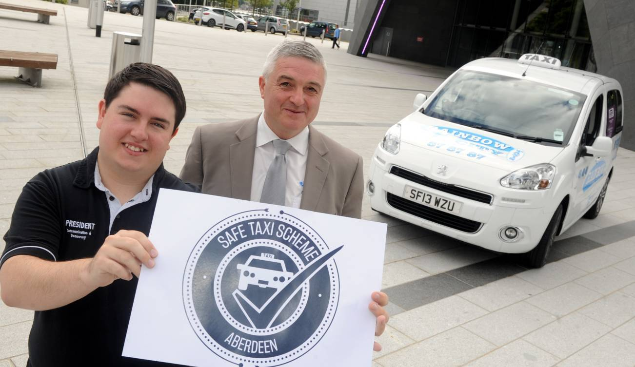 Edward Pollock, President of RGU's student union and Gordon McKay MD of Rainbow City Taxis.