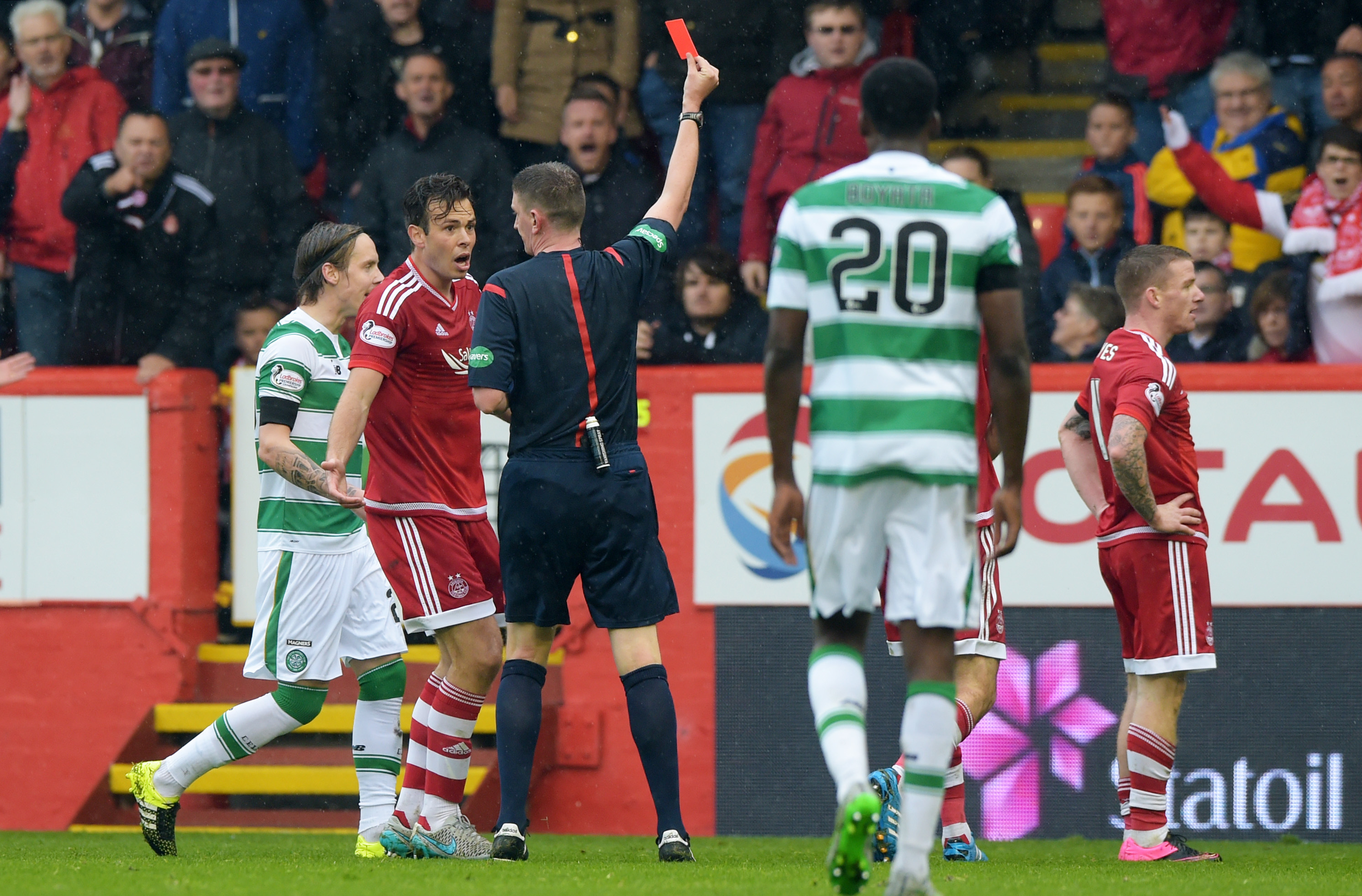 Aberdeen's Jonny Hayes (right) is shown a red card