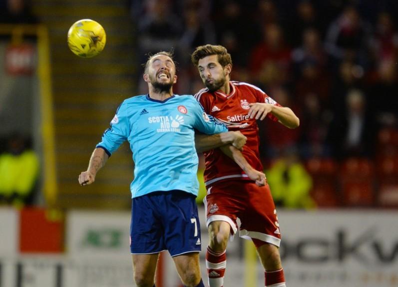 Aberdeen's Graeme Shinnie (right) battles for the ball against Hamilton's Dougie Imrie