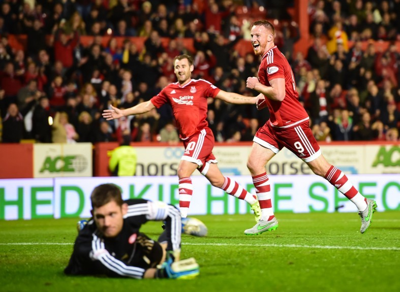 Aberdeen's Adam Rooney (9) celebrates having fired home from the penalty spot to put his side ahead