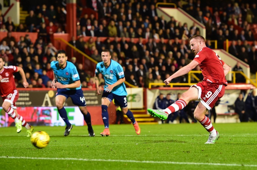 Aberdeen's Adam Rooney fires home from the penalty spot to put his side ahead