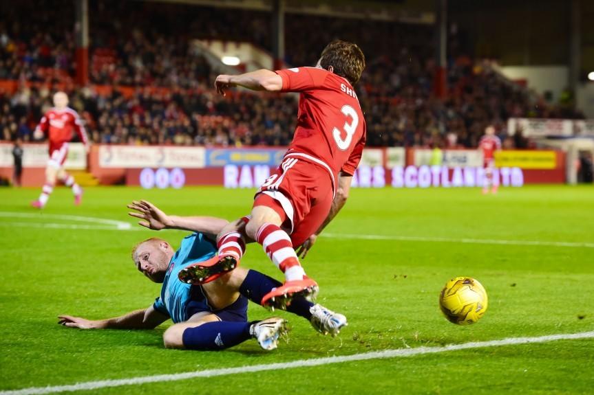 Hamilton's Ziggy Gordon (left) brings down Aberdeen's Graeme Shinnie and a penalty is awarded