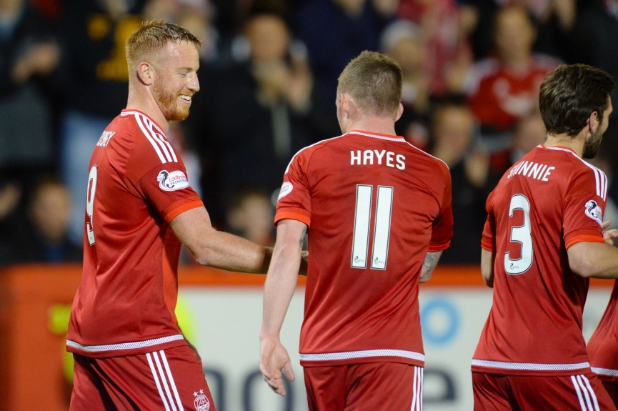 Aberdeen's Adam Rooney (left) celebrates with team-mate Jonny Hayes having fired home from the penalty spot to put his side ahead
