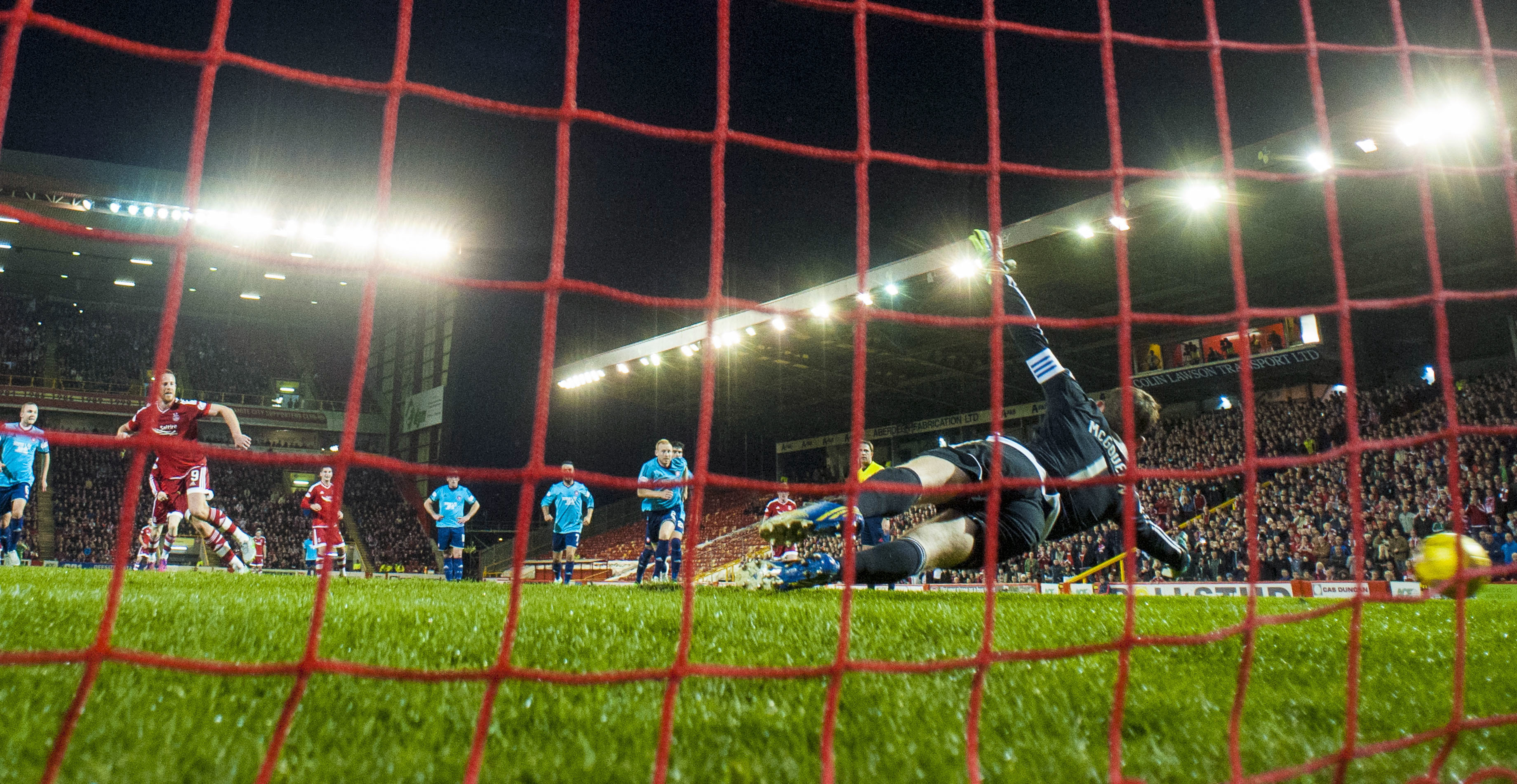 Aberdeen's Adam Rooney (left) wheels away having fired home from the penalty spot to put his side ahead.