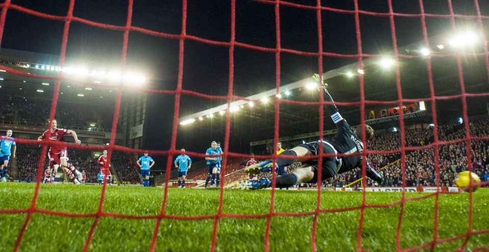 Aberdeen's Adam Rooney (left) wheels away having fired home from the penalty spot to put his side ahead