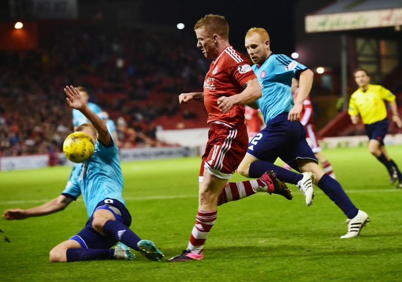 Jonny Hayes drives forward in possession and Aberdeen claim for a penalty