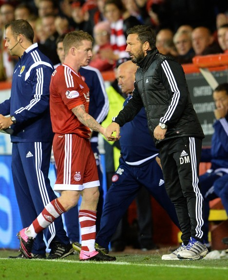 Aberdeen's Jonny Hayes (left) shakes hands with manager Derek McInnes as he is substituted