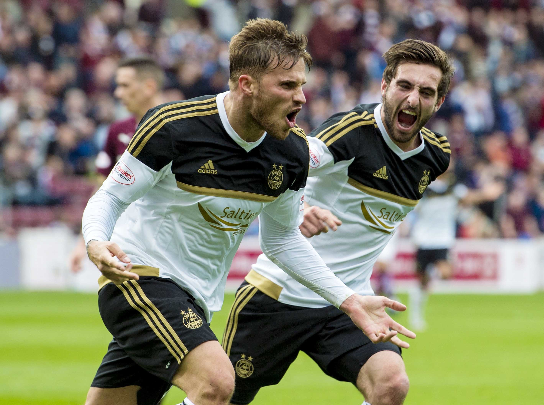 Aberdeen's David Goodwillie (left) celebrates with Graeme Shinnie having scored a brace in the first half