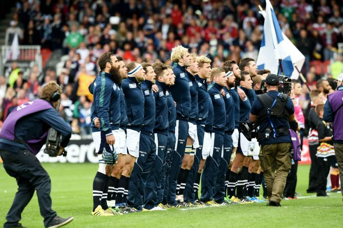 Scotland and Japan line up for their national anthems.