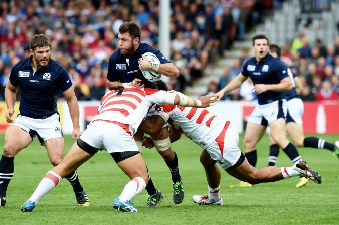 Scotland's Ryan Wilson (centre) is challenged by the Japan defence.
