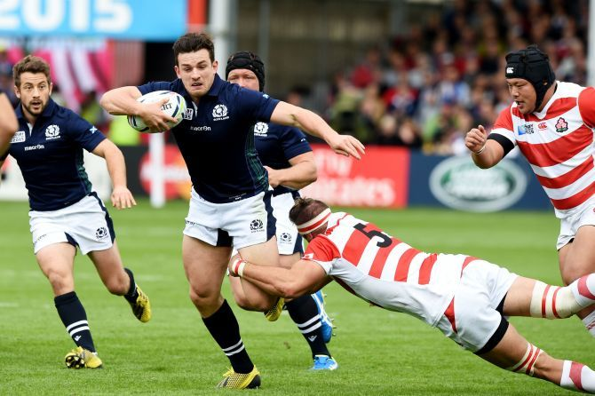 Scotland's Matt Scott (left) is challenged from Justin Ives.