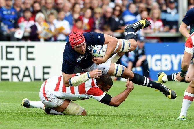 Grant Gilchrist (top) is challenged by Japan's Michael Leitch.