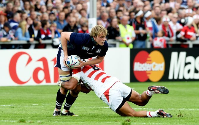 Jonny Gray (left) is challenged from Japan's Amanaki Mafi.