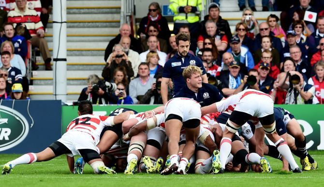 Scotland and Japan players battle in the scrum.