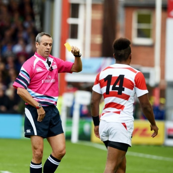 Japan's Kotaro Matsushima is shown a yellow card from referee John Lacey.