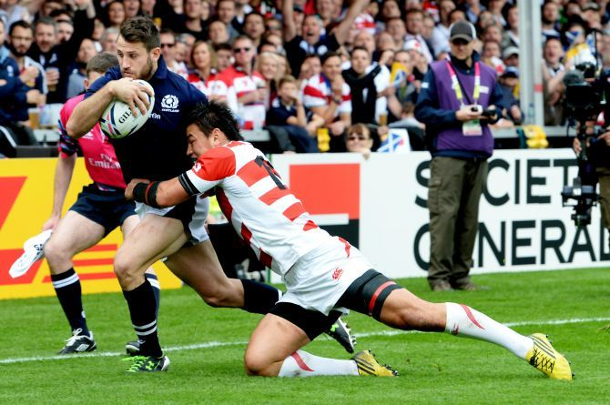 Japan's Ayumu Goromaru (right) challenges Tommy Seymour to stop him getting a try before half-time.