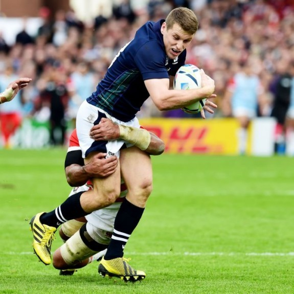 Scotland's Mark Bennett (top) battles with Japan's defence.