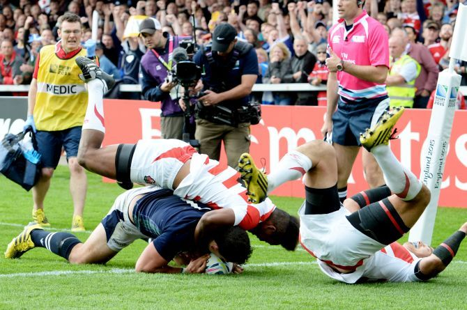 Scotland's John Hardie scores a try against Japan.