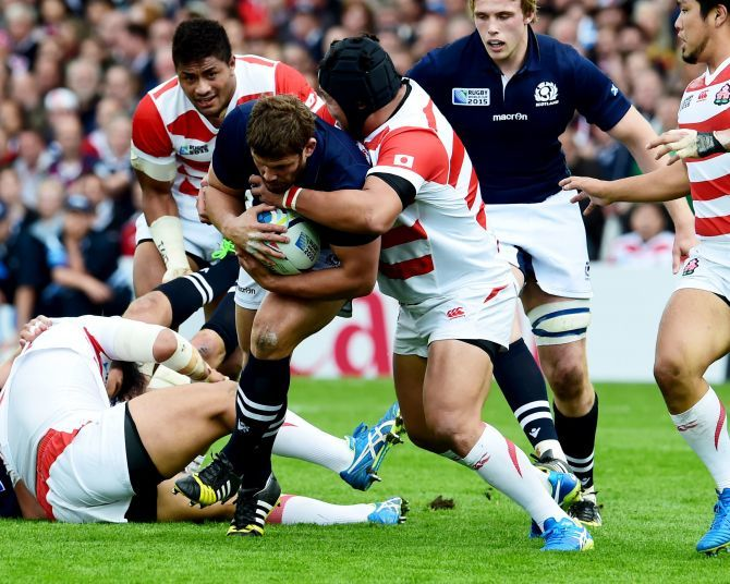 Ross Ford (left) battles with Japan's defence.