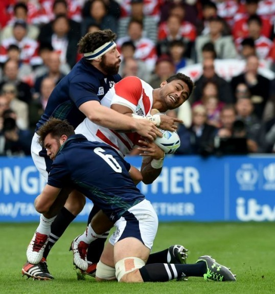 Scotland's Alasdair Dickinson (left) and Ryan Wilson (bottom) challenge Amanaki Mafi.