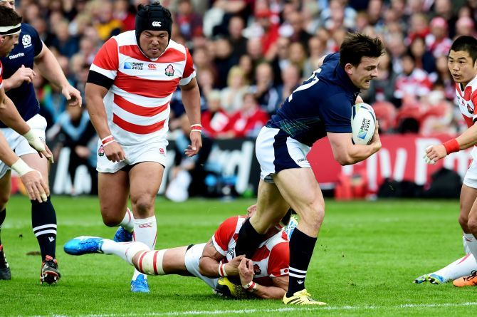Matt Scott (right) is challenged from Japan's Luke Thompson.