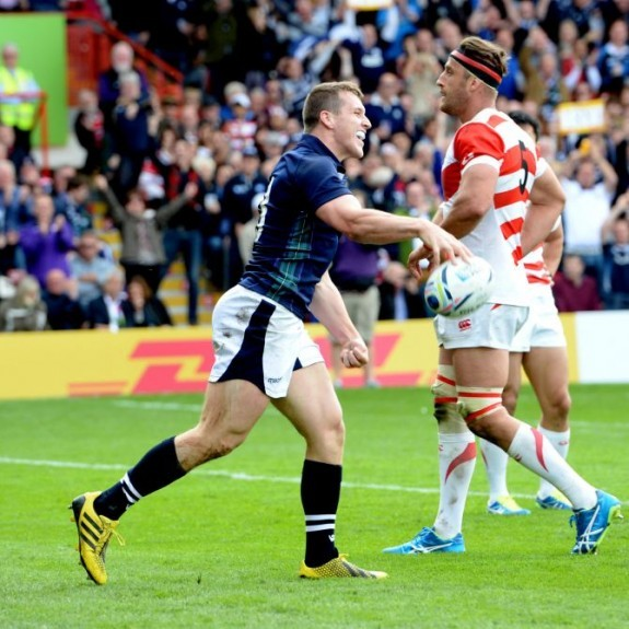 Mark Bennett is all smiles after scoring a try for Scotland.