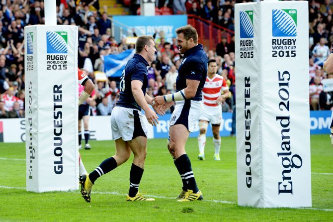 Mark Bennett (left) is all smiles after scoring a try for Scotland.