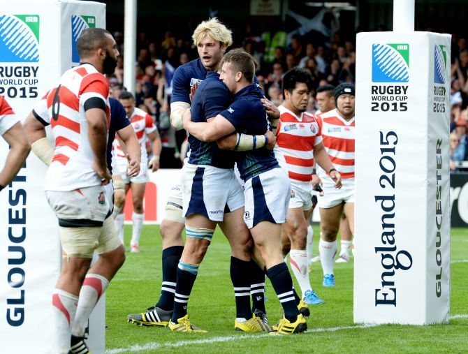 Mark Bennett (right) is all smiles after scoring a try for Scotland.