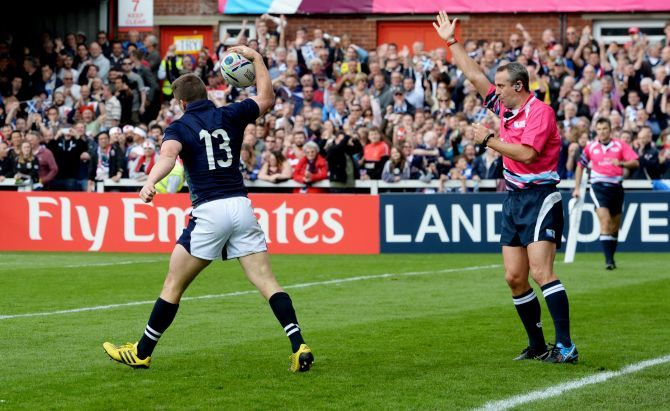 Mark Bennett scores a try for Scotland.