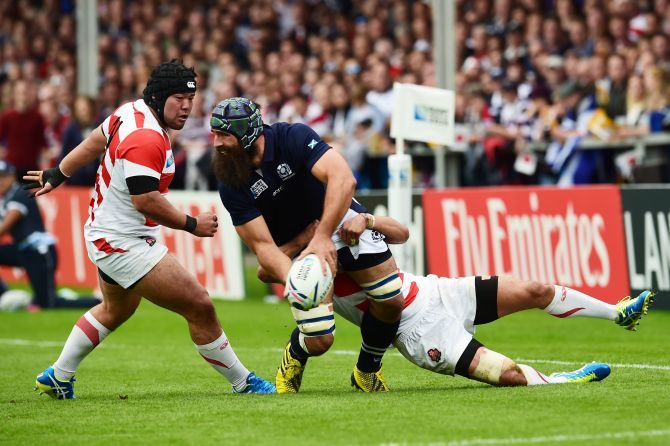 Josh Strauss (left) battles with Japan's defence.