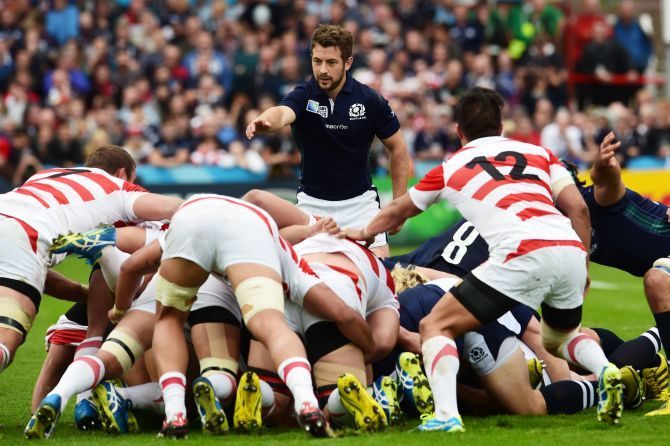 Scotland's Greig Laidlaw (top) watches over the scrum.