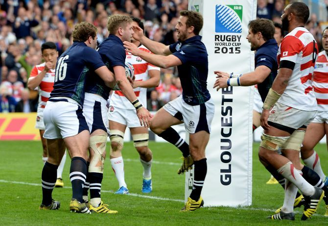 Finn Russell (2nd left) celebrates Scotland's try.