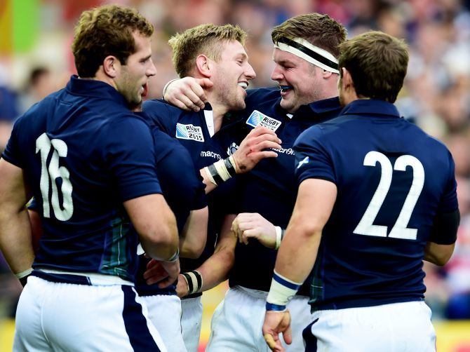 Finn Russell (2nd left) celebrates Scotland's try with team-mates.